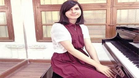 لولوة الشملان أول عازفة كويتية تصل العالمية
